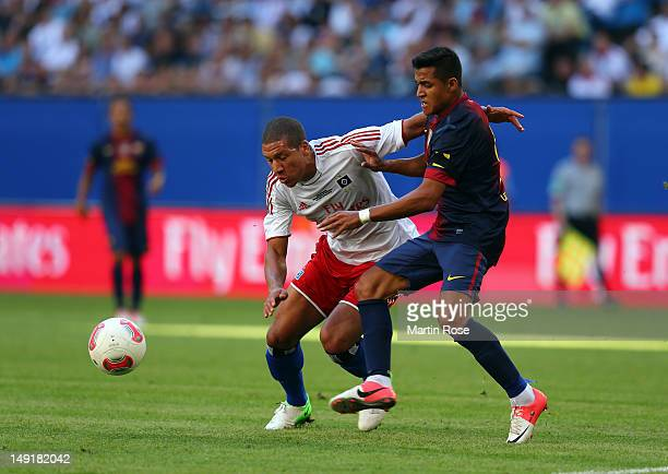 Jeffrey Bruma of Hamburg and Alexis Sanchez of Barcelona battle for the ball during the friendly match between Hamburger SV and FC barcelona at...