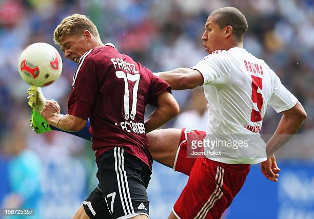 Jeffrey Bruma of Hamburg and Mike Frantz of Nuernberg compete for the ball during the Bundesliga match between Hamburger SV and 1. FC Nuernberg at...