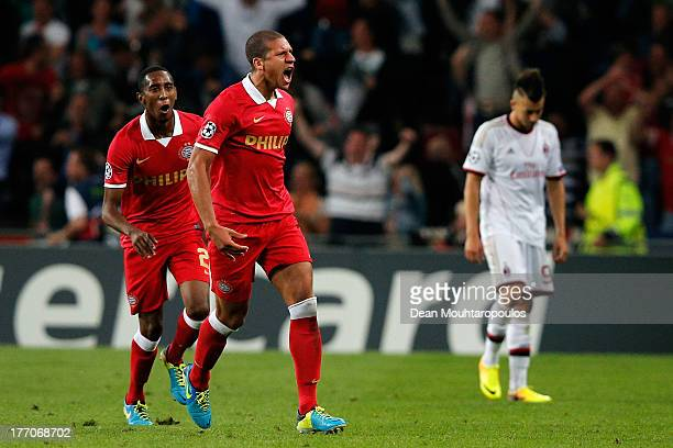 Jeffrey Bruma of PSV celebrates his team scoring a goal during the UEFA Champions League Playoff First Leg match between PSV Eindhoven and AC Milan...