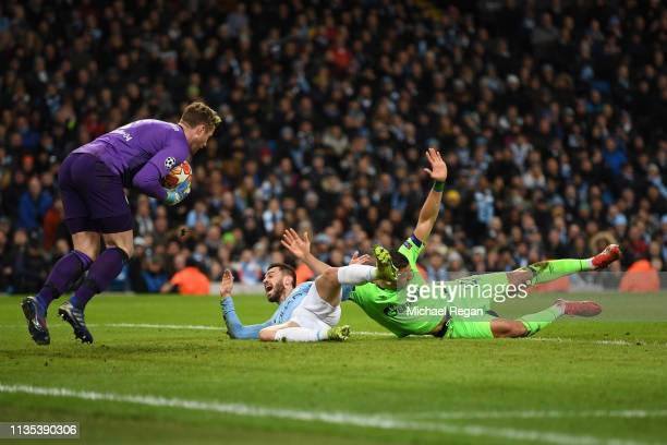 Jeffrey Bruma of Schalke 04 fouls Bernardo Silva of Manchester City which leads to a penalty being awarded during the UEFA Champions League Round of...