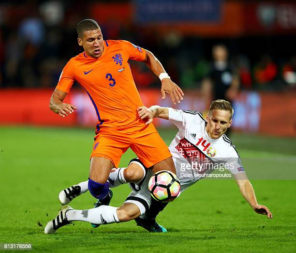 Jeffrey Bruma of the Netherlands battles for the ball with Sergei Kryvets of Belarus during the FIFA 2018 World Cup Qualifier between Netherlands and...