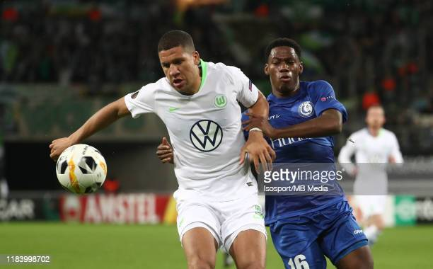 Jeffrey Bruma of Wolfsburg battles for the ball with Jonathan David of Kaa Gent during the UEFA Europa League group I match between KAA Gent and VfL...