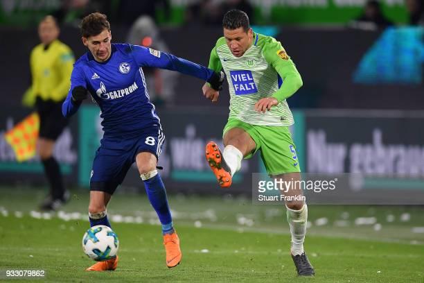 Jeffrey Bruma of Wolfsburg is chased by Leon Goretzka of Schalke during the Bundesliga match between VfL Wolfsburg and FC Schalke 04 at Volkswagen...