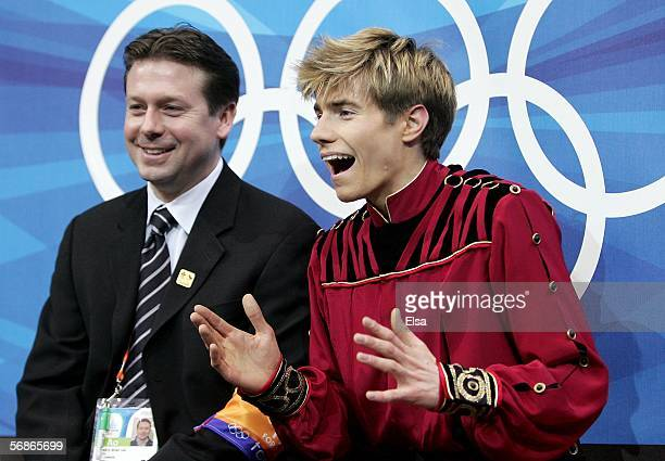 Jeffrey Buttle of Canada reacts as he receives his scores for the Men's Free Skate Program Final during Day 6 of the Turin 2006 Winter Olympic Games...