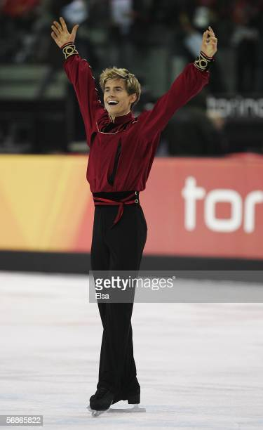 Jeffrey Buttle of Canada smiles after competing in the Men's Free Skate Program Final during Day 6 of the Turin 2006 Winter Olympic Games on February...