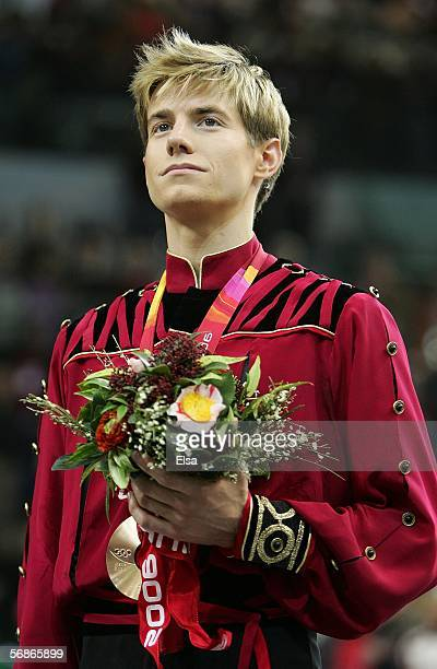 Jeffrey Buttle of Canada stands on the podium after winning the bronze medal in Men's Figure Skating following the Men's Free Skate Program Final...