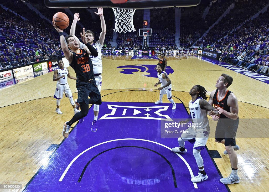 Jeffrey Carroll #30 of the Oklahoma State Cowboys drives to the basket against Dean Wade #32 of the Kansas State Wildcats during the second half on January 10, 2018 at Bramlage Coliseum in Manhattan, Kansas.