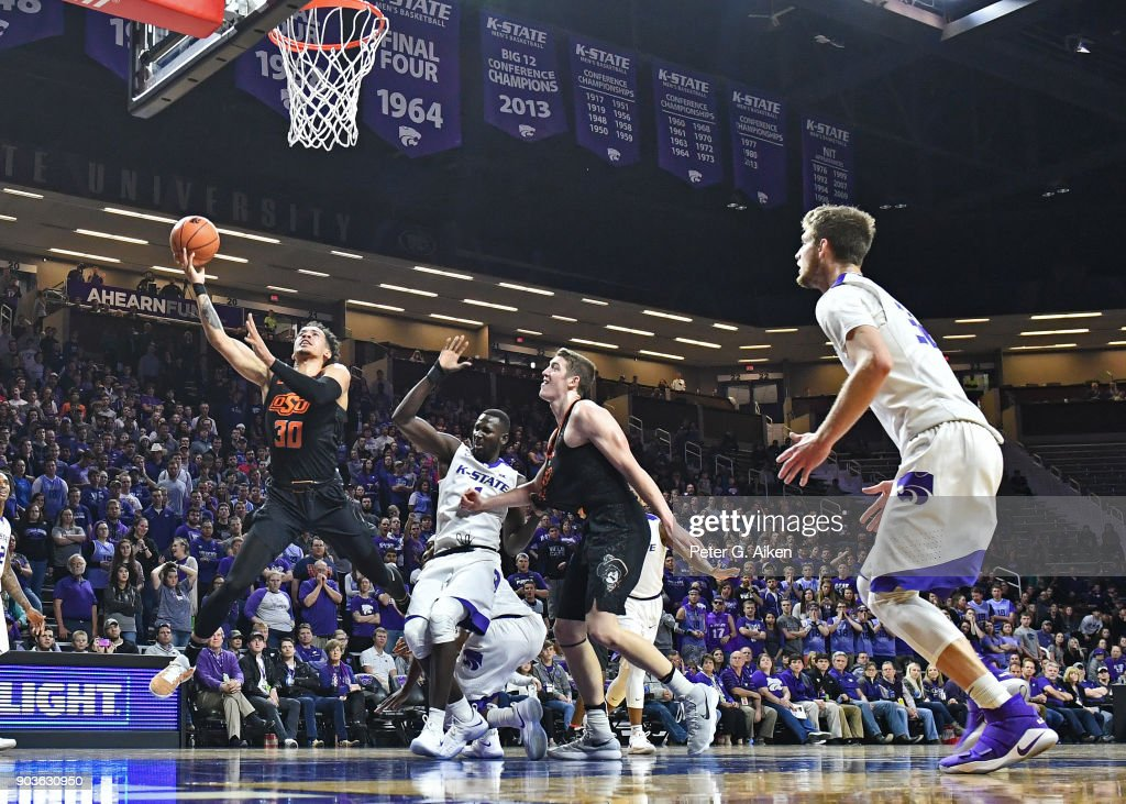 Jeffrey Carroll #30 of the Oklahoma State Cowboys drives to the basket against the Kansas State Wildcats during the first half on January 10, 2018 at Bramlage Coliseum in Manhattan, Kansas.