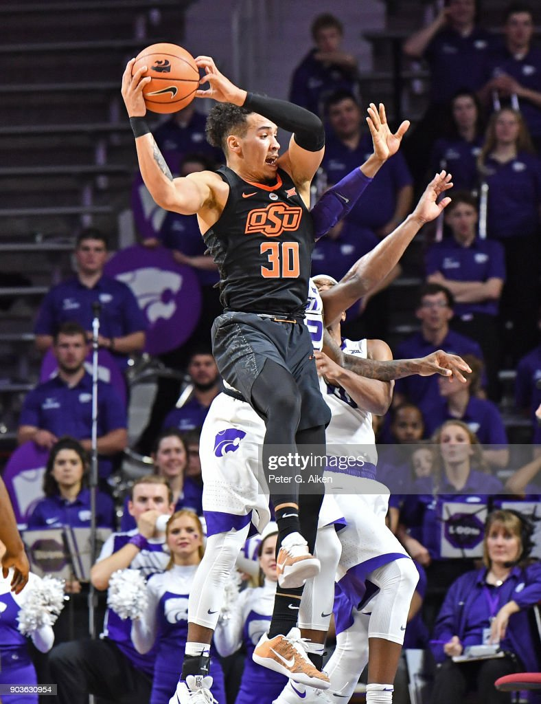 Jeffrey Carroll #30 of the Oklahoma State Cowboys grabs a offensive rebound against the Kansas State Wildcats during the second half on January 10, 2018 at Bramlage Coliseum in Manhattan, Kansas.