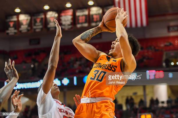Jeffrey Carroll of the Oklahoma State Cowboys shoots the ball over Jarrett Culver of the Texas Tech Red Raiders during the second half of the game on...