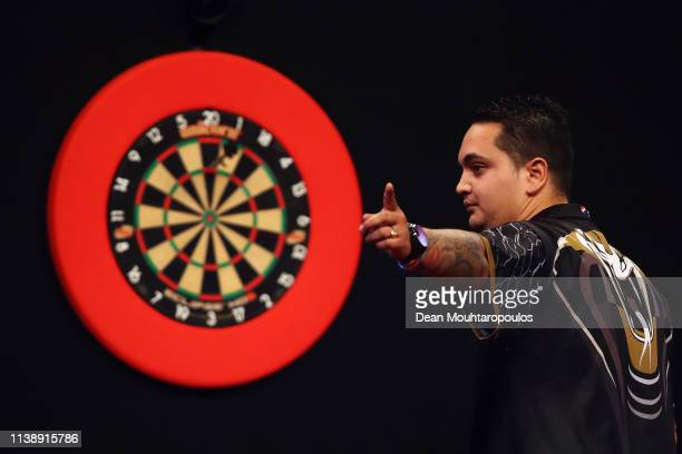 Jeffrey de Zwaan of the Netherlands celebrates as he competes against Rob Cross of England during day two of the 2019 Unibet Premier League Darts on...