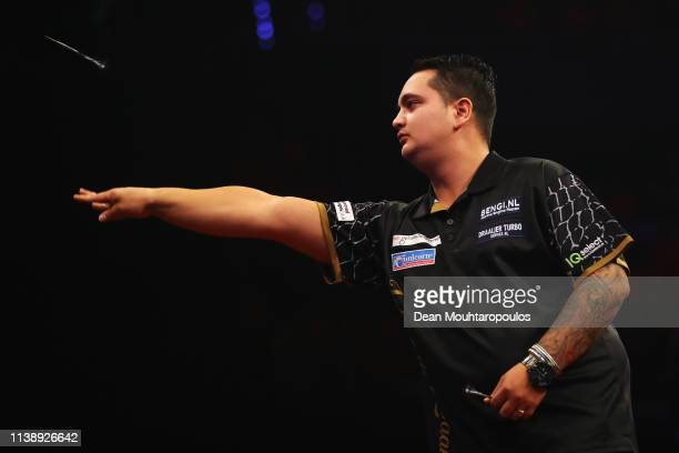 Jeffrey de Zwaan of the Netherlands competes against Rob Cross of England during day two of the 2019 Unibet Premier League Darts on March 28 2019 at...