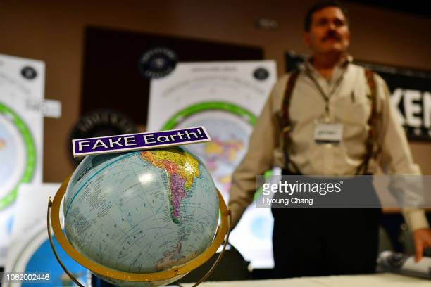 Jeffrey Diaz right is selling flat earth maps at his booth during Flat Earth International Conference at Crowne Plaza Denver Airport November 15 2018...