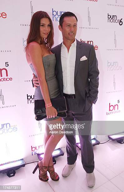 Jeffrey Donovan and Michelle Woods arrive at wrap party for Burn Notice at Fontainebleau Miami Beach on July 27 2013 in Miami Beach Florida
