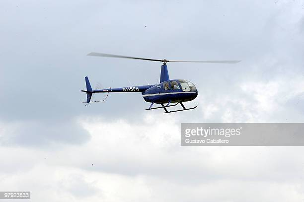 Jeffrey Donovan and Michelle Woods arrive via helicopter at the Piaget Gold Cup at the Palm Beach International Polo Club on March 21, 2010 in...