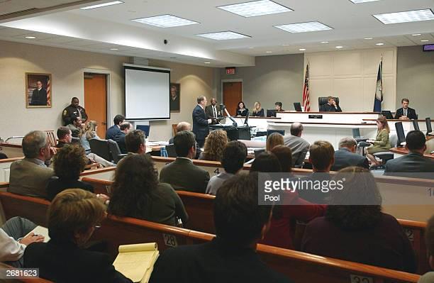 Jeffrey E. Miller, Fairfax crime scene investigator, tetifies on the witness stand during the trial of Washington area sniper suspect John Allen...