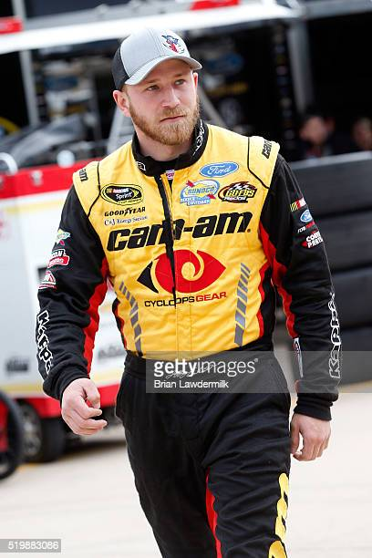 Jeffrey Earnhardt driver of the CanAm Ford walks through the garage area during practice for the NASCAR Sprint Cup Series Duck Commander 500 at Texas...