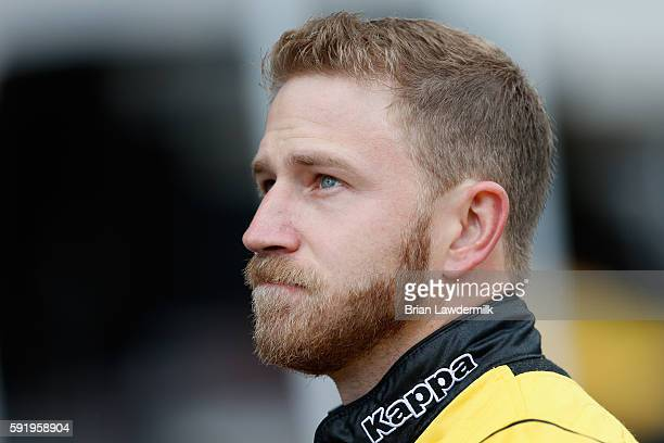 Jeffrey Earnhardt driver of the CanAm/Kappa Ford stands in the garage area during practice for the NASCAR Sprint Cup Series Bass Pro Shops NRA Night...