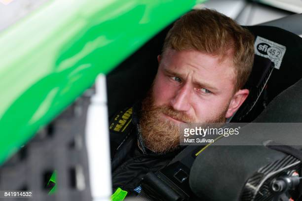 Jeffrey Earnhardt driver of the hulu Chevrolet sits in his car during qualifying for the Monster Energy NASCAR Cup Series Bojangles' Southern 500 at...