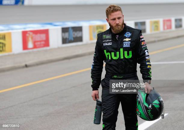 Jeffrey Earnhardt driver of the Hulu Chevrolet walks on the grid during qualifying for the Monster Energy NASCAR Cup Series FireKeepers Casino 400 at...