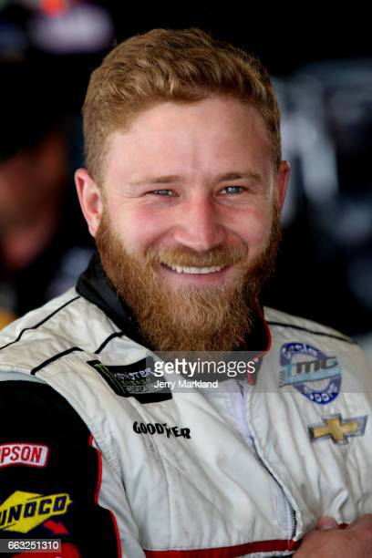 Jeffrey Earnhardt driver of the Little Joes Autos/Curtis Key Plumbing Chevrolet looks on from the garage during practice for the Monster Energy...