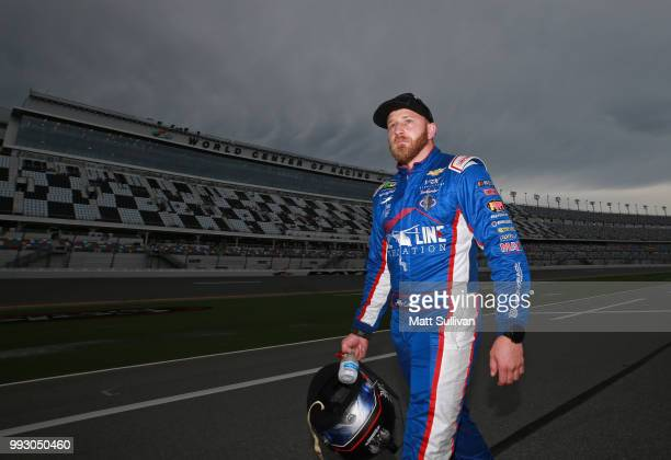 Jeffrey Earnhardt driver of the Nine Line Foundation Chevrolet walks to his car during qualifying for the Monster Energy NASCAR Cup Series Coke Zero...