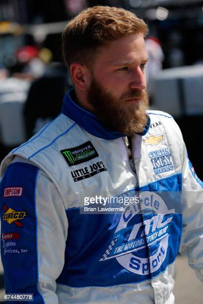 Jeffrey Earnhardt driver of the Towne Bank Chevrolet looks on during practice for the Monster Energy NASCAR Cup Series Toyota Owners 400 at Richmond...