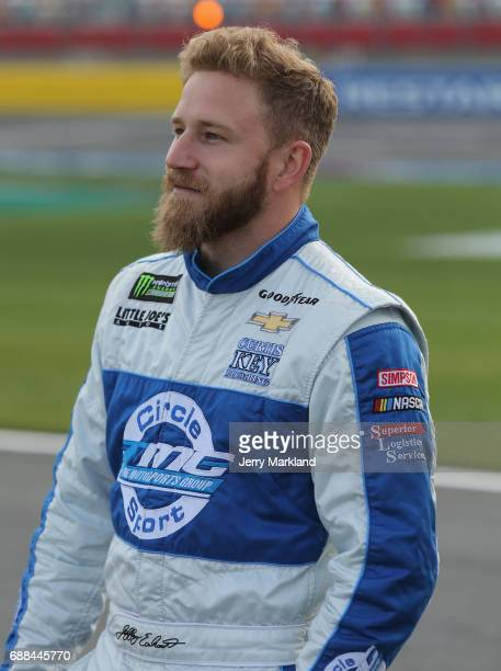 Jeffrey Earnhardt driver of the Towne Bank Chevrolet stands by his car during qualifying for the Monster Energy NASCAR Cup Series CocaCola 600 at...