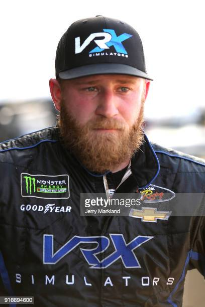 Jeffrey Earnhardt driver of the VRX Simulators Chevrolet looks on from the garage area during practice for the Monster Energy NASCAR Cup Series...
