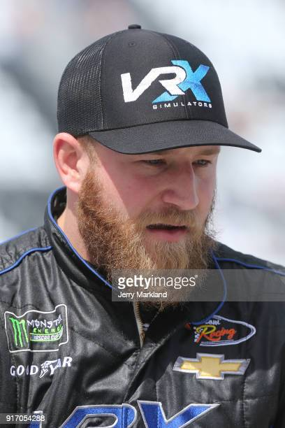 Jeffrey Earnhardt driver of the VRX Simulators Chevrolet looks on from the grid during qualifying for the Monster Energy NASCAR Cup Series Daytona...