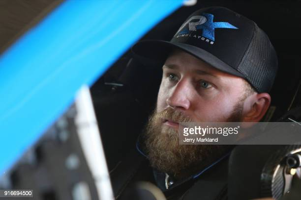 Jeffrey Earnhardt driver of the VRX Simulators Chevrolet sits in his car during practice for the Monster Energy NASCAR Cup Series Daytona 500 at...