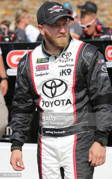 Jeffrey Earnhardt driver of the Xtreme Concepts/Project K9 Hero Toyota stands by his car during qualifying for the Monster Energy NASCAR Cup Series...