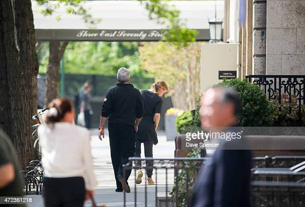 Jeffrey Epstein walking around with a mystery women May 5 2015 in New York City