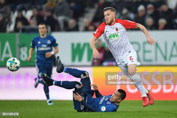 Jeffrey Gouweleeuw of Augsburg and Bobby Wood of Hamburg fights for the ball during the Bundesliga match between FC Augsburg and Hamburger SV at...