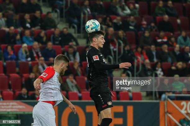 Jeffrey Gouweleeuw of Augsburg and Kai Havertz of Leverkusen battle for the ball during the Bundesliga match between FC Augsburg and Bayer 04...