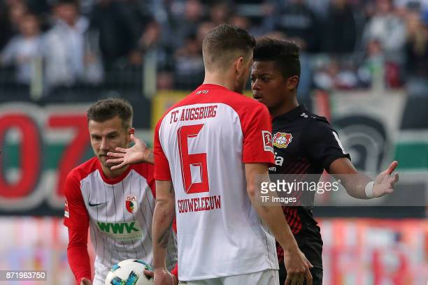 Jeffrey Gouweleeuw of Augsburg and Leon Bailey of Leverkusen during the Bundesliga match between FC Augsburg and Bayer 04 Leverkusen at WWKArena on...