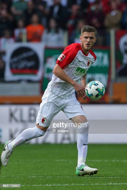 Jeffrey Gouweleeuw of Augsburg controls the ball during the Bundesliga match between FC Augsburg and Hannover 96 at WWKArena on October 21 2017 in...