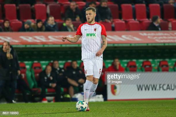Jeffrey Gouweleeuw of Augsburg controls the ball during the Bundesliga match between FC Augsburg and VfL Wolfsburg at WWKArena on November 25 2017 in...