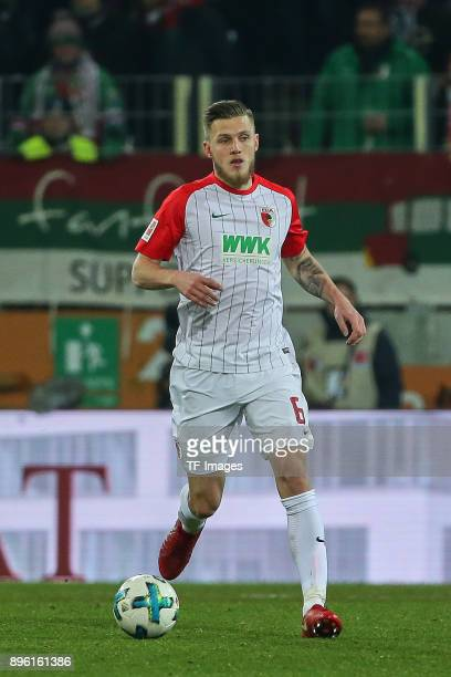 Jeffrey Gouweleeuw of Augsburg controls the ball during the Bundesliga match between FC Augsburg and SportClub Freiburg at WWKArena on December 16...