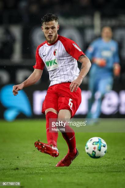Jeffrey Gouweleeuw of Augsburg controls the ball during the Bundesliga match between Borussia Moenchengladbach and FC Augsburg at BorussiaPark on...