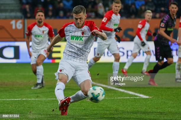 Jeffrey Gouweleeuw of Augsburg in action during the Bundesliga match between FC Augsburg and SportClub Freiburg at WWKArena on December 16 2017 in...