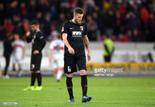 Jeffrey Gouweleeuw of Augsburg looks dejected following his sides defeat in the Bundesliga match between VfB Stuttgart and FC Augsburg at...