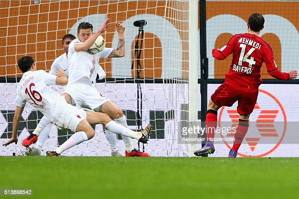Jeffrey Gouweleeuw of Augsburg plays the ball with the hand during the Bundesliga match between FC Augsburg and Bayer Leverkusen at WWK Arena on...