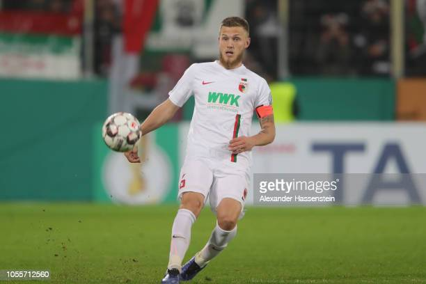 Jeffrey Gouweleeuw of Augsburg runs with the ball during the DFB Cup match between FC Augsburg and 1 FSV Mainz 05 at WWKArena on October 30 2018 in...