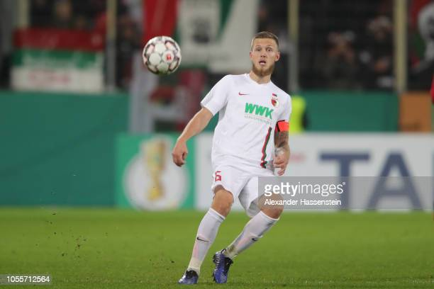 Jeffrey Gouweleeuw of Augsburg runs with the ball during the DFB Cup match between FC Augsburg and 1. FSV Mainz 05 at WWK-Arena on October 30, 2018...