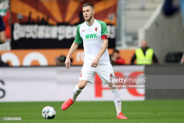 Jeffrey Gouweleeuw of Augsburg runs with the ball during the Bundesliga match between FC Augsburg and Borussia Moenchengladbach at WWK-Arena on...