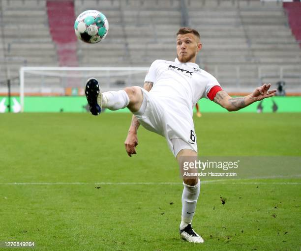 Jeffrey Gouweleeuw of Augsburg runs with the ball during the Bundesliga match between FC Augsburg and Borussia Dortmund at WWK-Arena on September 26,...