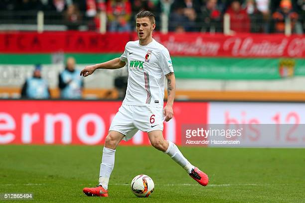 Jeffrey Gouweleeuw of Augsburg runs with the ball during the Bundesliga match between FC Augsburg and Borussia Moenchengladbach at WWK Arena on...