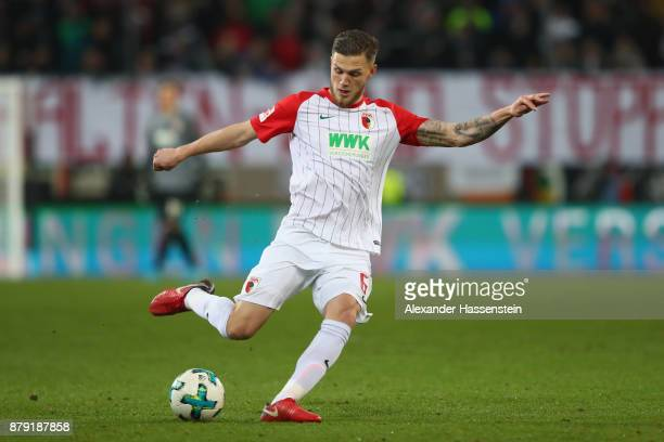 Jeffrey Gouweleeuw of Augsburg runs with the ball during the Bundesliga match between FC Augsburg and VfL Wolfsburg at WWKArena on November 25 2017...