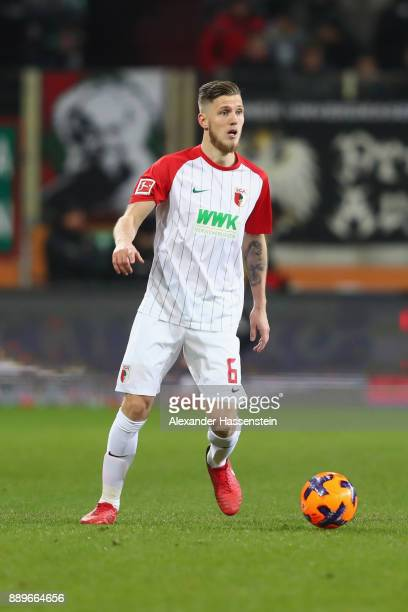 Jeffrey Gouweleeuw of Augsburg runs with the ball during the Bundesliga match between FC Augsburg and Hertha BSC at WWKArena on December 10 2017 in...